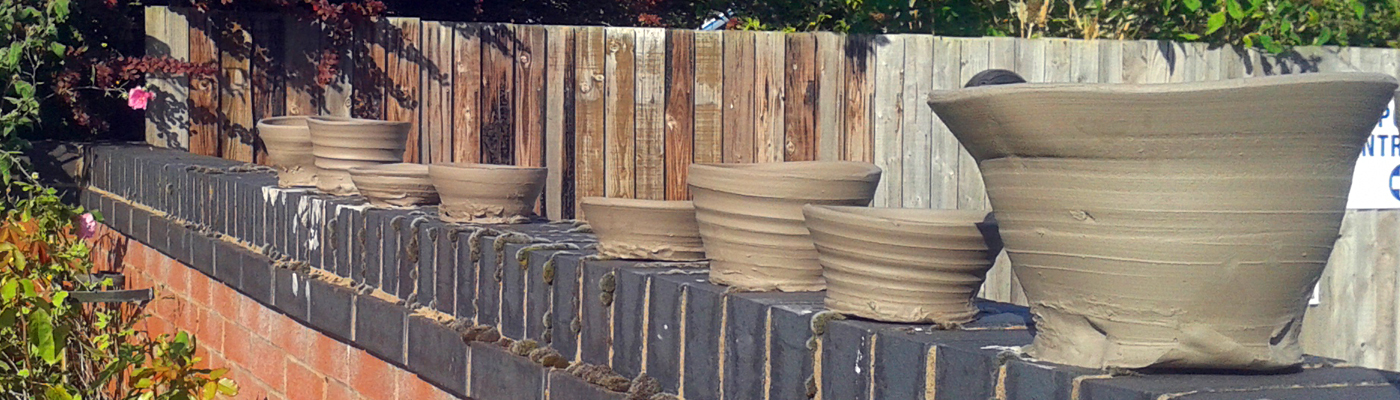 Pottery Drying on a Wall