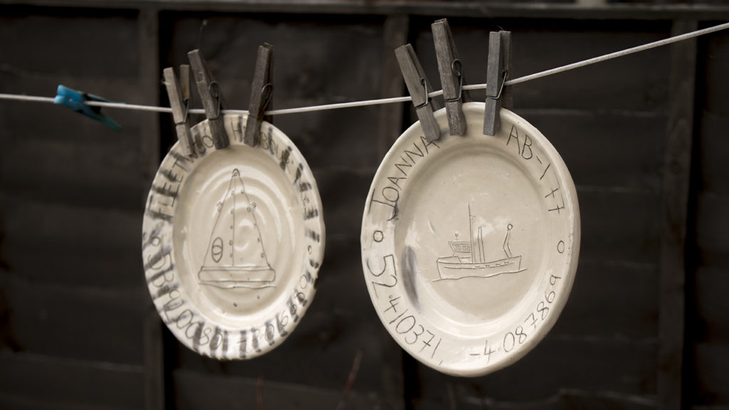 Plates hanging on the line